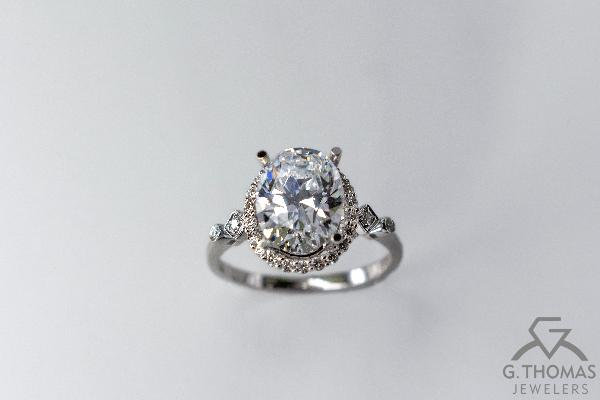 X045-47878: white gold oval engagement ring